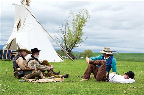 Mountain men relax during the Fort Connah rendezvous.