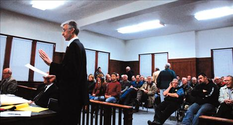 Western Montana Water Users attorney Brian Shuck presents a point for District Judge C.B. McNeil to ponder during a jam-packed hearing on Feb. 14 at the Lake County Court house. Attorney Jon Metropoulos represented the Flathead Joint Board of Control and the irrigation districts.