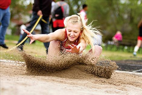 Arlee's Carly Hergett competes in the long jump.