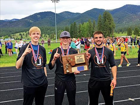 Ronan boys track team members pose with their 2016-17 Divisional Championship trophy.