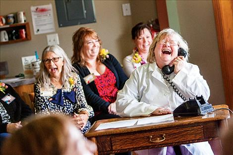 Members of the The Ronan Woman's Club perform a skit to celebrate their 100th Anniversary.