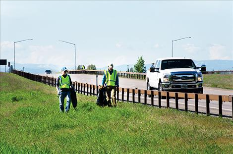Salish Kootenai College faculty members pick up trash along U.S. Highway 93 during a day of community service the college observes annually.