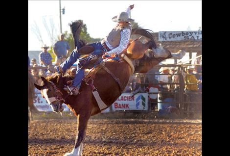 Sterling Davis participates in the Pioneer Days saddle bronc event.
