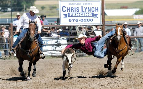 Will Powell prepares to take down a steer during the Pioneer Days steer wrestling event.