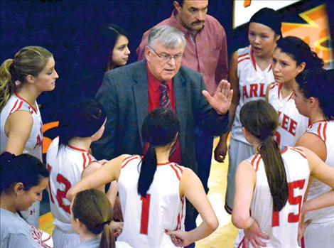 Head coach Richard Bachmeier instructs the Arlee Scarlets during the District 14-C tournament two weeks ago. The Scarlets were undefeated until their meeting with Gardiner in the first round of divisionals last weekend.