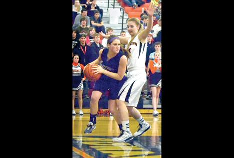 Jessica Bagnell rounds the corner toward the bucket Friday against Frenchtown.