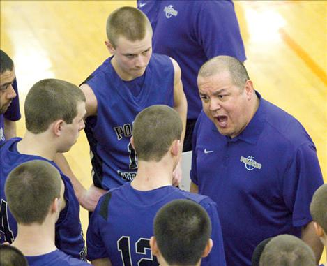 Pirate head coach Brad Pluff rallies the troops during Polson's game against Columbia Falls Friday. The Pirates all sported shaved heads for the divisional tournament.