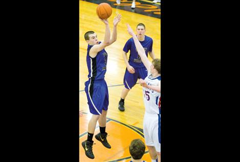 Senior Hayden Congdon shoots for two as Will Davey watches during Polson's game against Columbia Falls Friday.