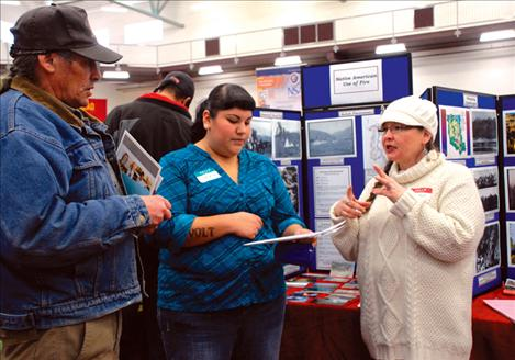 Roian Matt, right, and James Morigeau answer student Sasha Rivers' questions about the Confederated Salish and Kootenai Tribal Division of Fire.