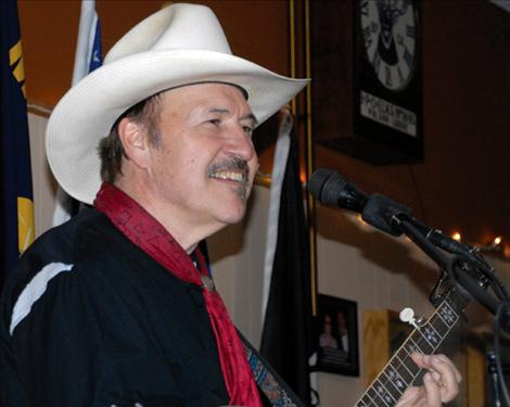 Entertainer/songwriter Rob Quist smiles before launching into a song at the Winterfest. Quist writes and sings songs about the people and places of the west.