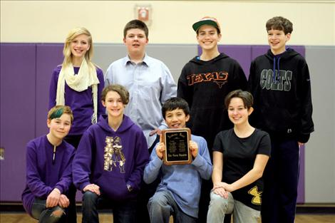 Polson students Hannah Madsen, Carson McDaniel, Timothy Russell, Matthew Sitter, Geneva Des Lions, Anna Young, Linde Lambson and Sierra Garcia pose for a group portrait after winning Polson's third straight Lake County Academic Bowl.