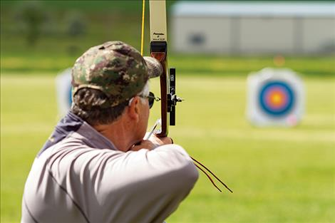 Bob Byers of Polson takes aim at gold.