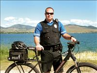 Biking at work: Polson policeman pedals on patrol