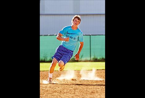 Tyson Petticrew races around second during the relay around bases event. Petticrew and his teammates won the event.