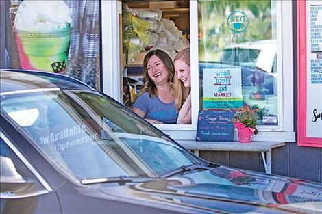 Tanya Patrick and Tasha Avison greet a customer at their Small Town Girl Coffee business north of Polson.