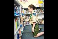 Boy Scout builds bookcase for library