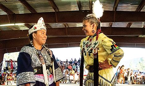 Allyshia Manuel, left, last year's Miss Salish Pend d'Oreille, passes the honor to this year's representative, Leniece Trahan.