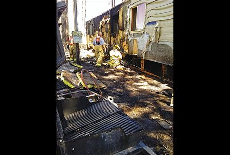 A trailer caught fire on Light Road after a spark caught pine needles on fire.