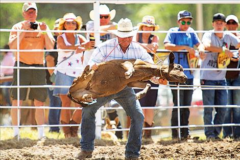 Colt Stonehocker of Charlo flips his steer during the tie down event.