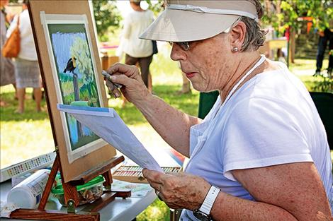 Juanita Small Salmon works on a pastel painting. The painting will be donated to the Ninepipes Museum to be auctioned off during a fundraiser at a later date.