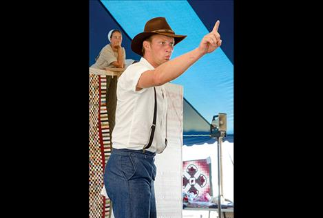 Caleb Troyer enthusiastically catches a bid during the 15th annual Amish Community Auction.