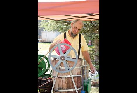 Robert Miller churns homemade ice cream.