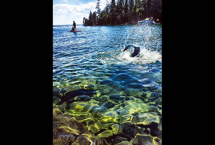 "POLSON – Annette Schiele reports seeing an interesting object in the Flathead Lake: ""My family and I were enjoying the beach at Bull Island on July 2, along with many other lake-goers, when my daughter, Anna Schiele, snapped this picture. We think it is a mermaid. The gentleman on the paddle board, we didn't get his name, alerted his family that he saw a mermaid as well."""