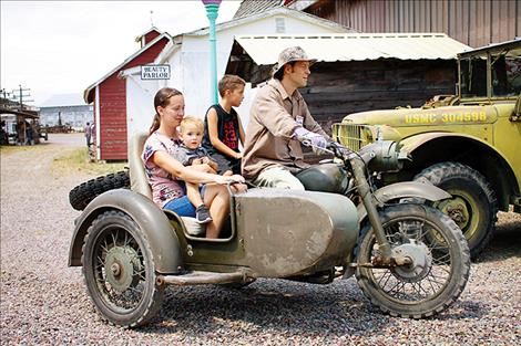 David Bosley gives Leroy, Aiden and Nicole Burland a ride on a retired military motorcycle. The motorcycle and several other retired military vehicles are used during Live History Days to give rides around the museum grounds.