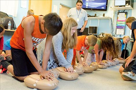Kids learn CPR skills during a two-day training program.