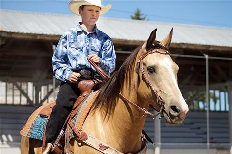 Tanner Bergh rides in the Lake County Fair Horse Show Monday morning.