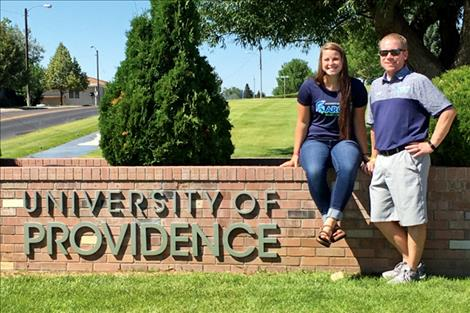 Jenna Evertz poses with Lady Argos soccer head coach Brian Clarke.