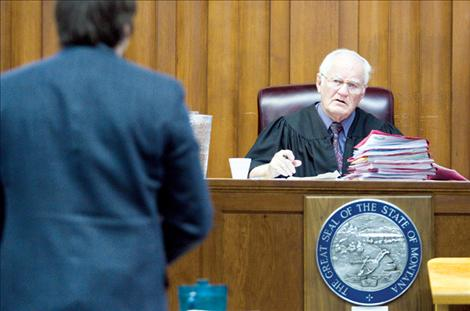 Lake County District Judge C.B. McNeil listens to Deputy County Attorney James Lapotka during court proceedings Feb. 27.