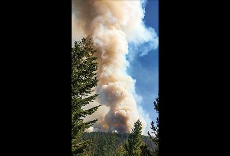 Posted on the Division of Fire's Facebook page on July 26, the photo shows a plume of smoke from the Liberty fire which, as of Monday morning, has burned more than 1,800 acres of Mission Mountain tribal wildnerness.