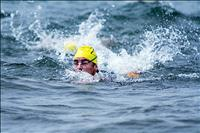 Braving waves: swimmers compete in windy conditions during open swim race