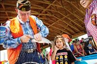 Kids get hooked on fishing at Pioneer Days fishing derby