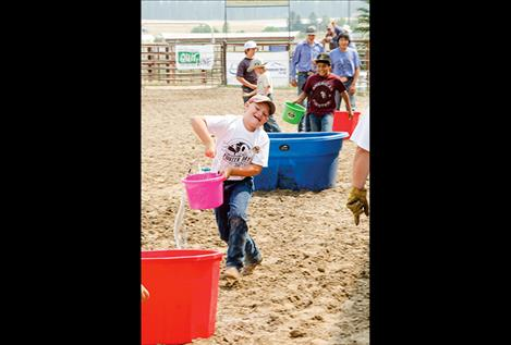 n this competition, some participants ran so fast across the arena all their water had sloshed out of their buckets.