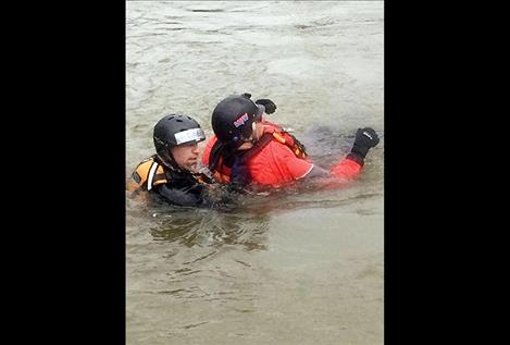 "Gabe Ouellette, a member of Lake County Search and Rescue, is a rescue swimmer, or ""live bait,"" in the Swan River as he and a victim are pulled to shore with a rope during a training in May."