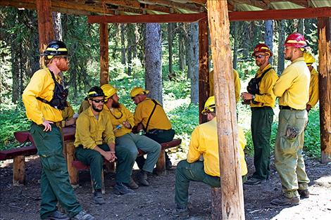 A fire crew in from South Carolina takes a break while waiting for their next orders. Fire crews from as far as Canada and New Mexico are also on site.