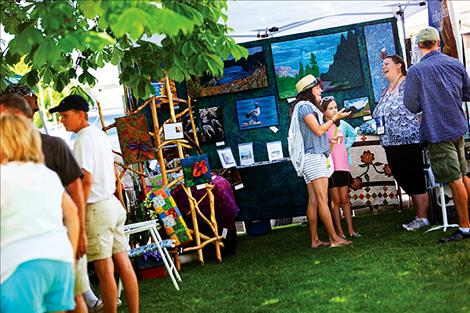 Like the 2015 festival pictured left, art created using a variety of mediums will be displayed and sold at the Sandpiper's annual art festival on the courthouse lawn this Saturday.