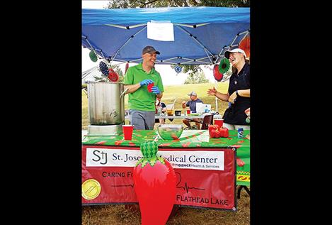 Landon Godfrey and Shelley Quinn share a laugh Saturday at the Rotarians' Chili Cookoff at Riverside Park. They were part of a team from St. Joseph's Hospital, one of 13 that competed.