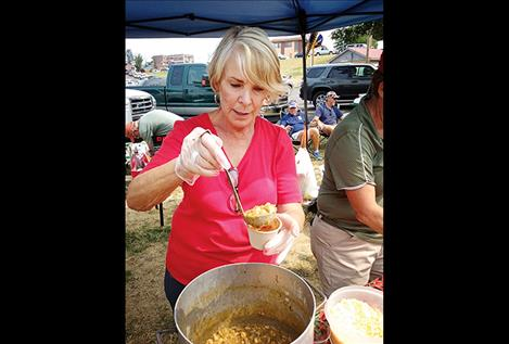 Jeanette Phillips serves some chili verde with pork and white beans for the Red Hot Chili Mamas, who won the People's Choice award and placed third overall.