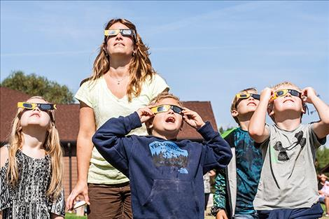 Marion Shanks, Jamie Shanks, Rider Furshong, Rand Shanks and Michael Furshong marvel at  the eclipse  with special  glasses.