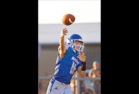 Bulldogs' quarterback Troy Mitchell throws a pass.