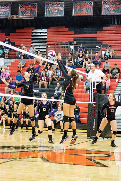 Maiden Madeline McCrea (9) and Lady Pirate Mikaela DuCharme battle at the net.