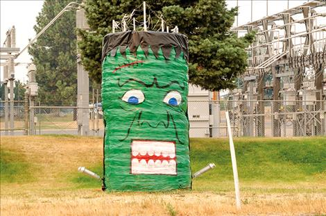 Mission Valley Power crew turns two hay bales into the electricity-sparked Frankenstein creature.