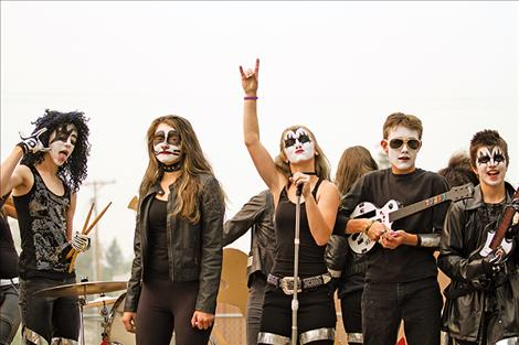 """The Charlo eighth-graders rock out on their float """"KISS the warriors goodbye"""" during Charlo's homecoming parade on Friday."""