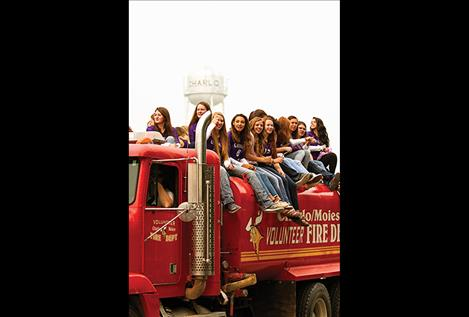 Charlo's volleyball team rides on the fire truck during the parade.