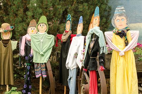 Scarecrows, built by a team of community members, will be sold at this weekend's Harvest Fest to help offset the cost of watering the flowers that grace Main Street in Ronan.