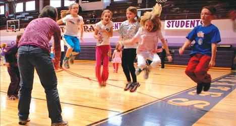 Getting some air, Ali Hupka, left, Hailey Helm, Madeleine Bissegger, Aubree Roberts and Owen McElwee jump as Deanna McElwee twirls the circle rope.