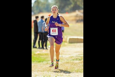Polson's Bea Frissell  races toward the finish line, winning the Mission Shadow Duels girls' race with a time of 18:49.